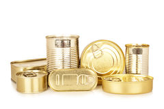Assortment of golden food tin can. Reflected on white background Royalty Free Stock Photos