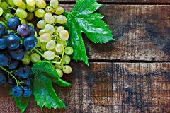 Assortment of grapes on a wooden table Royalty Free Stock Image