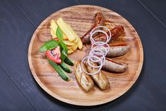 Assortment of grilled sausages stock photography