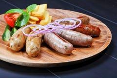 Assortment of grilled sausages stock photos