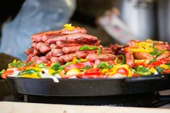 Assortment of grilled sausages at market Stock Photo