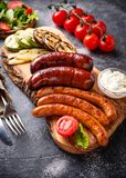 Assortment of grilled sausages and vegetables. Selective focus Stock Photography