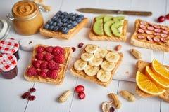 Assortment of healthy fresh breakfast toasts stock photo