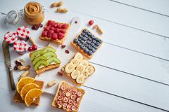 Assortment of healthy fresh breakfast toasts royalty free stock photography