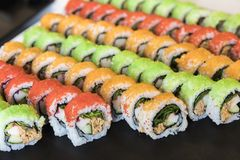 Assortment of healthy multicolored maki sushi rolls stock photos