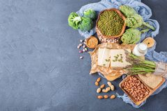 Assortment of healthy vegan protein source and body building food. Tofu soy milk beans asparagus broccoli artichokes almond peanut pumpkin chia flax seeds Stock Photography