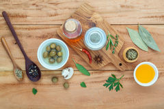 Assortment of herbs rosemary ,thyme,sage, mint,bay leaves , pepper and parsley set up with wooden background concept for. International cuisine royalty free stock photography