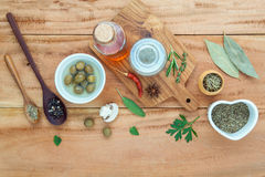 Assortment of herbs rosemary ,thyme,sage, mint,bay leaves , pepper and parsley set up with wooden background concept for. International cuisine royalty free stock photos