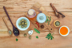 Assortment of herbs rosemary ,thyme,sage, mint,bay leaves , pepper and parsley set up with wooden background concept for. International cuisine royalty free stock photo