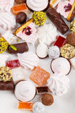 Assortment of homemade confectionery. On white background. Marshmallow, zephyr, marmalade, jelly, chocolate candies, truffles, turkish delight, lokum. Top view Royalty Free Stock Photography