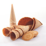 Assortment of icecream cones and cornets. In different shapes and sizes together with wafer biscuits on a white background Royalty Free Stock Photos