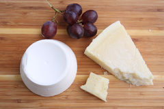 Assortment of Italian cheese and grapes Royalty Free Stock Image