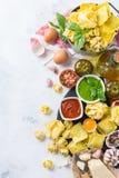 Italian food and ingredients, ravioli pasta spaghetti pesto tomato sauce. Assortment of italian food and ingredients, ravioli pasta spaghetti pesto tomato sauce Stock Image