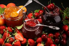 Assortment of jams, seasonal berries, apricot, mint and fruits. marmalade or confiture royalty free stock images