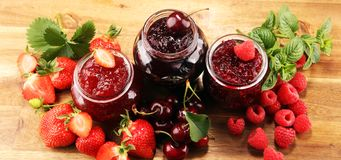 Assortment of jams, seasonal berries, cherry, mint and fruits in glass jar royalty free stock image