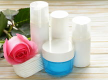 Assortment of jars creams lotion with flowers Stock Image