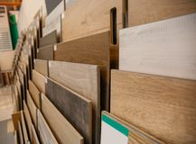 Assortment of laminated flooring samples. In hardware store royalty free stock images