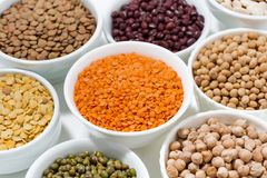 Assortment of legumes in bowls royalty free stock photography