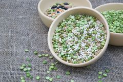 An assortment of legumes and cereals in a clay dish Stock Image