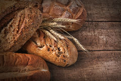 Assortment of loaves of bread on wood stock photos