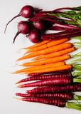 An assortment of loose raw beets and carrots. On white background Stock Image