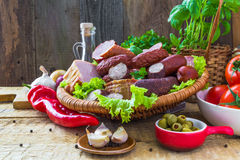Assortment meats sausage bacon vegetables Royalty Free Stock Photos