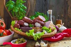 Assortment meats sausage bacon vegetables Stock Photos