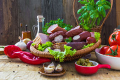 Assortment meats sausage bacon vegetables Stock Photography