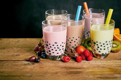 Assortment of milky bubble teas with fruit stock photography