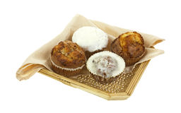 Assorted muffins in wicker basket Stock Images