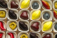 Assortment of multi-colored exquisite chocolates, candy chocolate royalty free stock photography