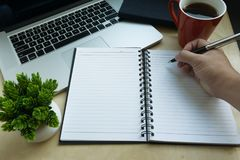 Writing on Blank Notebook. Assortment of multiple home business tools Stock Images