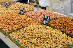 Assortment of nuts and almonds on market stand Royalty Free Stock Photos