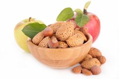 Assortment of nuts and apples Royalty Free Stock Image