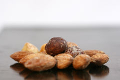 Assortment of nuts on black background. Pic Assortment of nuts on bright background Royalty Free Stock Photography