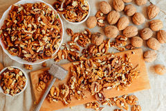 Assortment of nuts. Bowl of walnuts on wooden texture. Walnuts a Stock Images