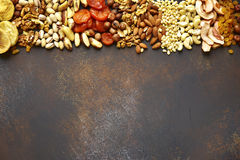 Assortment of nuts,dried fruits and seeds.Concept of healthy sna stock photography