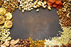 Assortment of nuts,dried fruits and seeds.Concept of healthy sna royalty free stock images