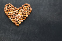Assortment of nuts in a heart shape. Stock Image