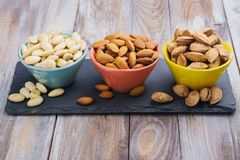 Free Assortment Of Almond Nuts - Peeled And Fried, Unpeeled And Almonds In Shells Royalty Free Stock Images - 105222749