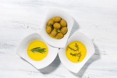 Free Assortment Of Different Types Of Olive Oil In White Bowls Stock Photos - 94216983