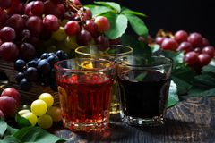 Free Assortment Of Grape Juice On Wooden Background, Closeup Royalty Free Stock Image - 109683046