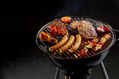Free Assortment Of Marinated Meat Grilling On A BBQ Stock Image - 88974781