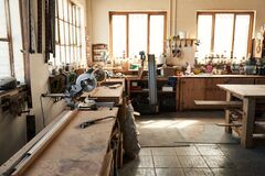 Free Assortment Of Tools On Workbenches In A Woodworking Shop Royalty Free Stock Image - 169861856