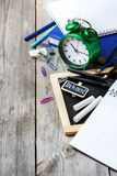 Assortment of office and school supplies on wooden table Stock Photography