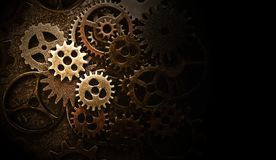 Assorted old gears. Assortment of old metal gears with black for copy space royalty free stock photos