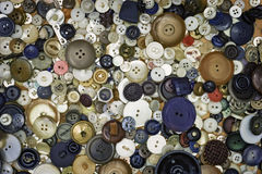 An Assortment of Old Vintage Buttons in Various Sizes. An assortment of old vintage buttons layed out flat - just like grandma used to have. Suitable for a stock photos
