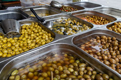 Assortment of olives in conserve from a market Royalty Free Stock Photo