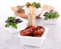 Assortment of olives and dried tomato Royalty Free Stock Photography