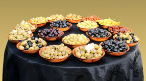 Assortment of olives and mediterranean vegetables. On a table stock photography